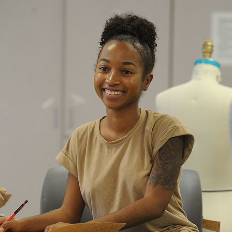 A student in Kent State's Fashion School works on a project in a design classroom.