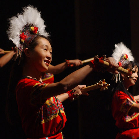 Members of the Tzu-Chi foundation perform an aboriginal dance at the Festival of Nations event during International Education Week.