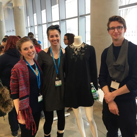 A team of students display the interactive dress they created at the Fashion/Tech Hackathon.