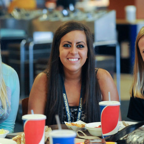 Three Kent State University students pose for a photo during lunchtime at a Kent Campus dining hall.