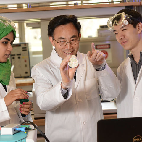 Yanhai Du (center), Kent State assistant professor in the College of Applied Engineering, Sustainability and Technology, teaches students about fuel cell technology.