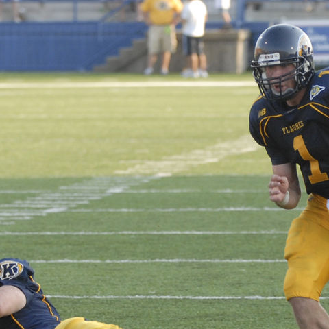 Julian Edelman, Kent State's former quarterback, runs the ball down the field in a 2006 game against Miami University.