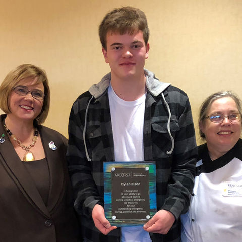 Dylan Elson (center) poses with Dr. Little (left), and Lorinda Craver (right)