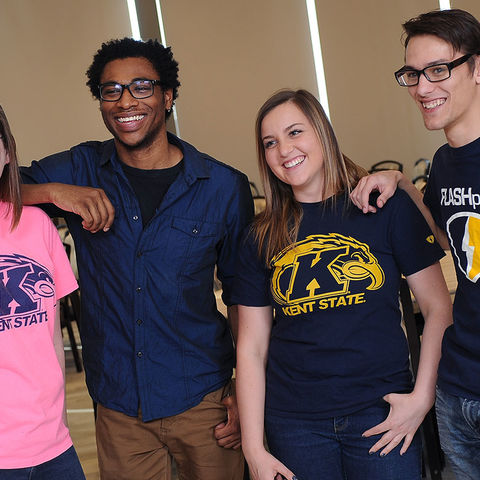 Kent State students smile at an event on campus. Kent State student organizations sponsor more than 250 events on campus each year.