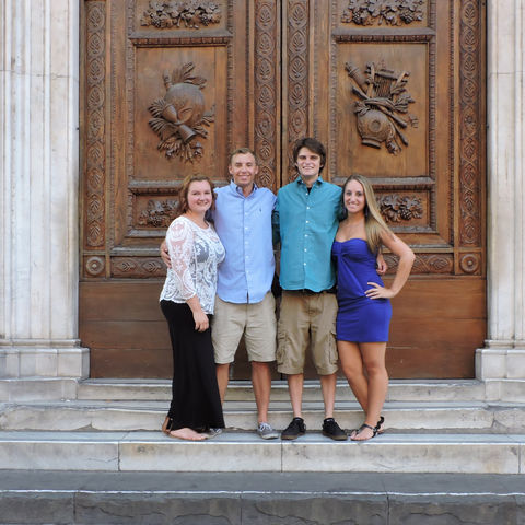 Kent State University hospitality management students Jackie Myers, Zach Anderson, Michael Farber and Andrea Sutton pose for a photo in front of a doorway on the side of the Duomo in Florence, Italy.
