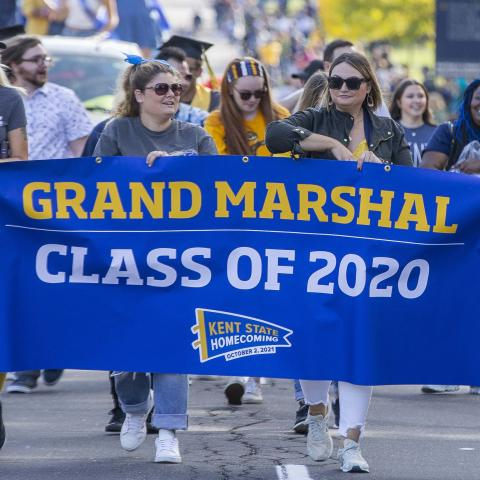 Members of the Class of 2020 lead the way down Main Street, serving as the 2021 Homecoming Parade Grand Marshals.