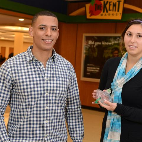 Kent State students Essien Cobham, a senior mathematics and computer science major, and Samantha Phillips, a junior athletic training major, worked together to save the life of a visiting high school student outside of the second floor cafeteria in the Ke