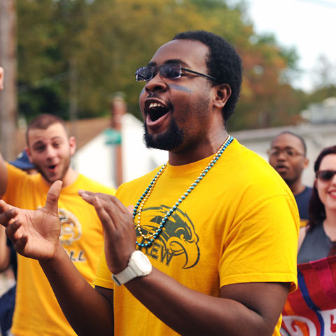 A group of Kent State students enjoy participating in the 2013 Homecoming parade.