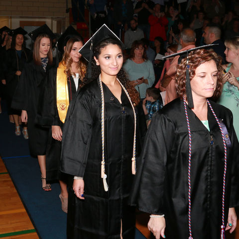 Graduating students enter the gymnasium for the spring 2017 commencement ceremony on the Ashtabula campus