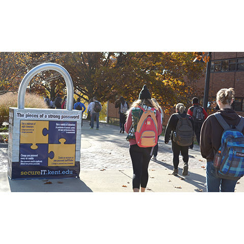 "Students pass by the ""Password"" lock along the esplanade between classes"