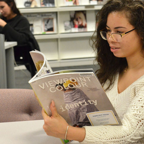 A Fashion Industry Studies grad student studies in the Fashion Library