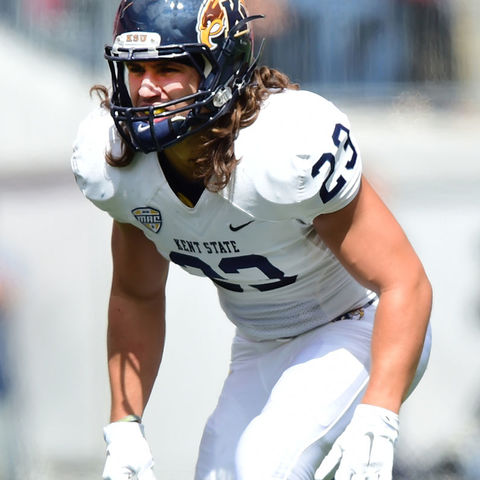 Kent State safety Jordan Italiano sizes up an opponent's wide receiver just before the start of a play during the 2014 season.
