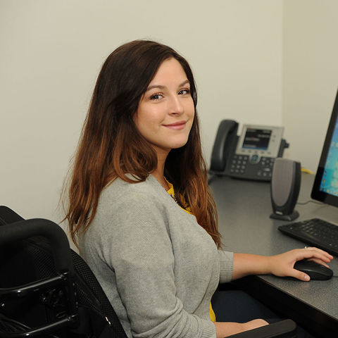 Kent State graduate student Lauren Ledzianowski uses video teleconferencing to help students in rural school districts with speech-language therapy.