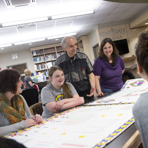 Students from the Geauga campus discuss a project with a professor.