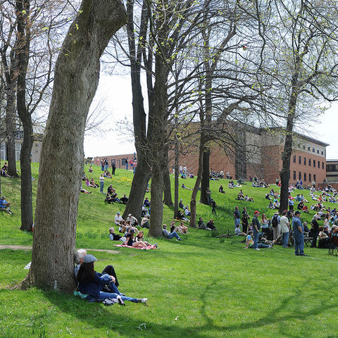 Kent State faculty, staff, students and campus visitors gather on the Kent State Commons and Blanket Hill for the 45th annual commemoration of May 4, 1970.