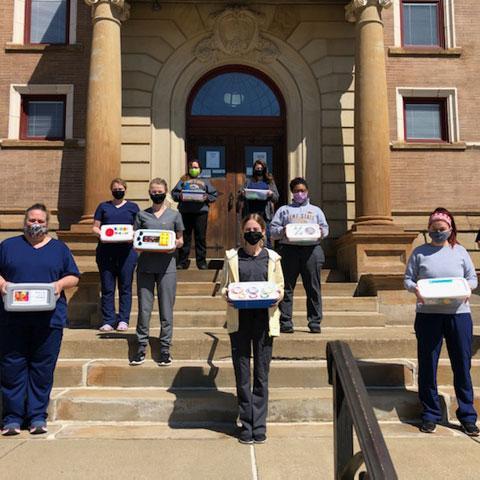 OTA Students show off their sensory shoe boxes