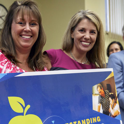 Mary Heidler (left) recieves her surprise visit from Melissa Dyer and the University Teaching Council