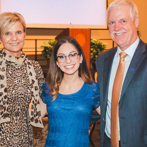 Madison Hoenes poses with her scholarship donors, Vicki and Rick Haines, at the annual scholarship dinner at Kent State Stark.