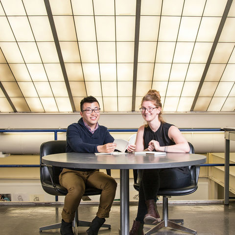 Will Scharlott (left), senior visual communication design major, and Aiofe Mooney (right), assistant professor in the School of Visual Communication Design