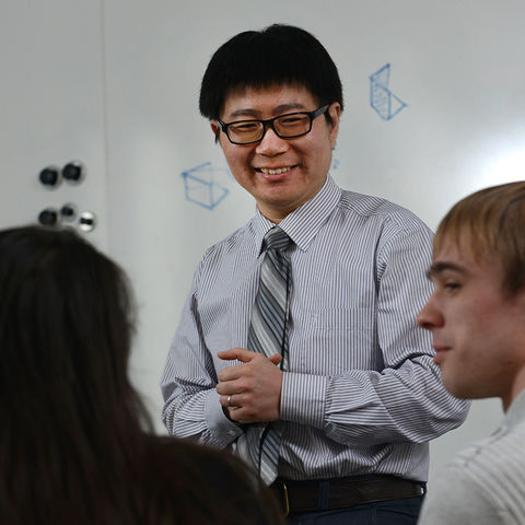 Rui Liu, assistant professor in the College of Architecture and Environmental Design, leads a discussion in a classroom on the third floor of Taylor Hall. Liu has been selected as Kent State's Scholar of the Month.