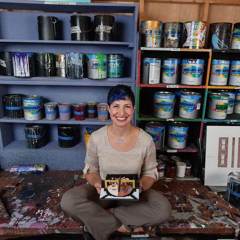 Tamara Honesty poses in the School of Theatre and Dance's Scene Shop