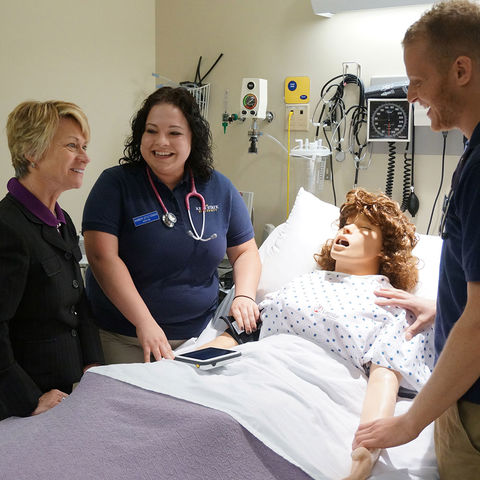 Nursing students at Kent State University at Tuscarawas share their learning experience with President Beverly Warren.