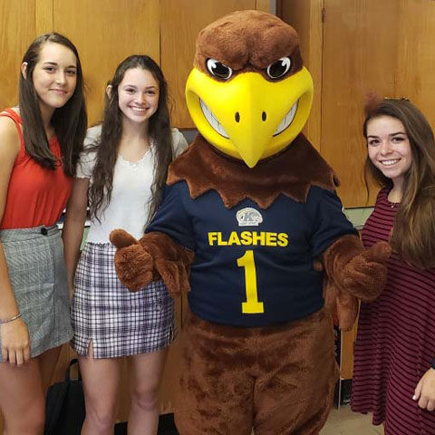 The captains of the Salem High School volleyball team with Flash. They include (from left) Hayden Carner, Elly Exline and Jenna McClish.