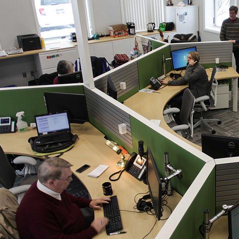 WKSU News staff members work on their stories in the station's newsroom.