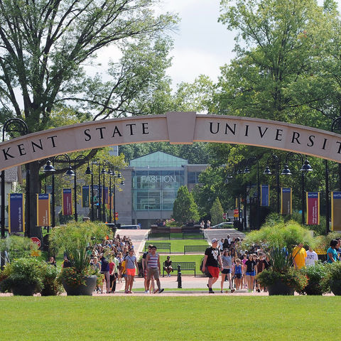 Kent State students file past the arch on the Lefton Esplanade on their way to downtown Kent during last year's Welcome Weekend.