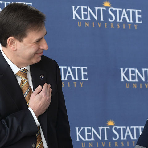Kent State President Beverly J. Warren acknowledges the new director of the university's Brain Health Research Institute, Michael N. Lehman, Ph.D.