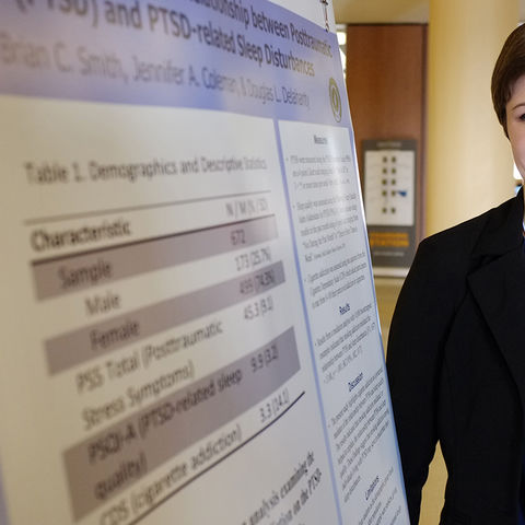 Kent State student Celeste Weise stands near her research poster during the 2015 Undergraduate Research Symposium in the Kent Student Center.