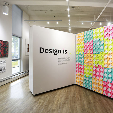 """Display of the sign for the """"Design is"""" graduate student show"""