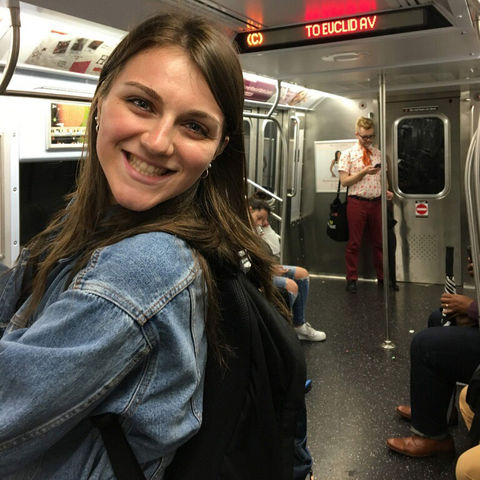 BSN graduate Bailey Hill smiling in NYC subway