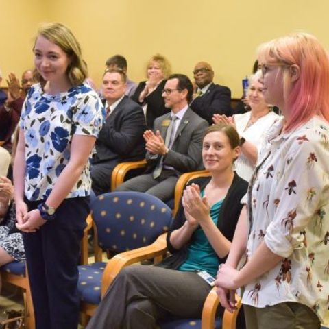 Kent State students Gracen Gerbig, left, and Hayley Shasteen, right, were recognized at the May 9 Board of Trustees meeting.