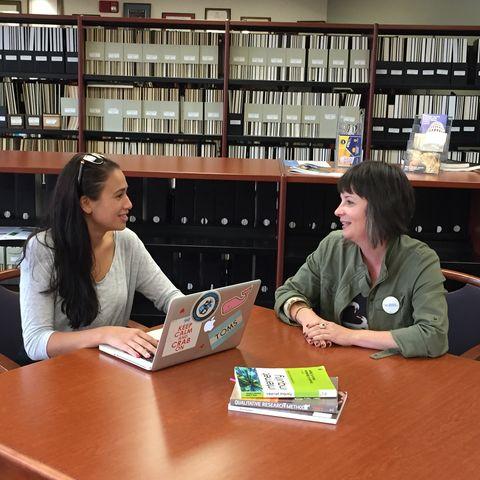Megan Carrasco (left) and Dr. Suzy D'Enbeau (right), assistant professor of communication studies, discuss Carrasco's thesis research.