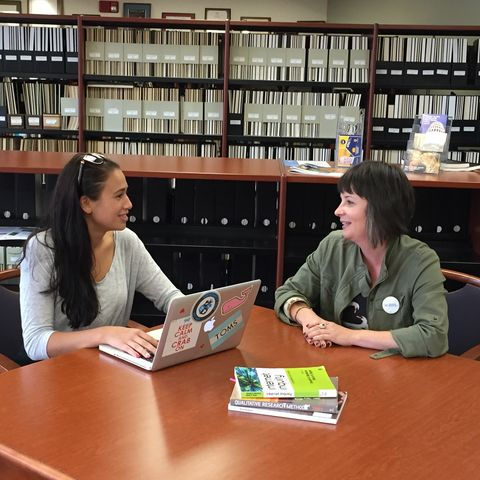 Megan Carrasco (left) and Dr. Suzy D'Enbeau (right), assistant professor of communication studies, discuss Carrasco's thesis research.