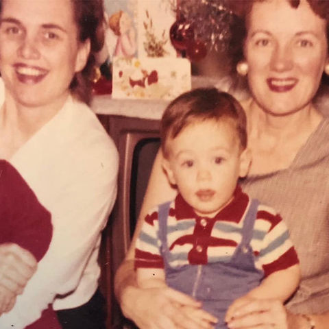 Tom Jennings as a child, sitting on his mother's lap (left)