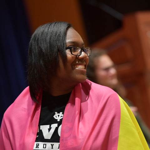 Student poses at lgbtq welcome