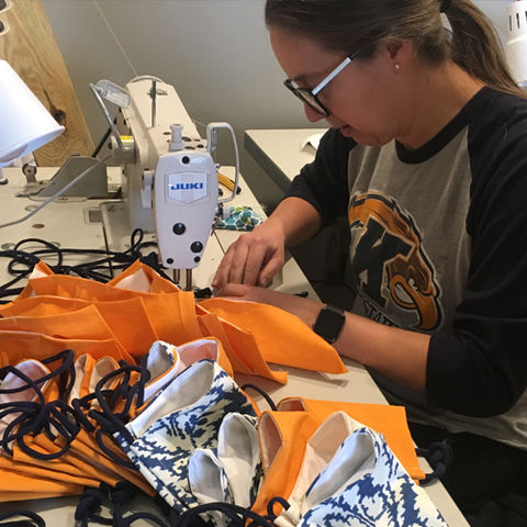 Professor Linda Ohrn-McDaniel working on the first batch of 500 masks that were donated to medical facilities in Northeast Ohio.