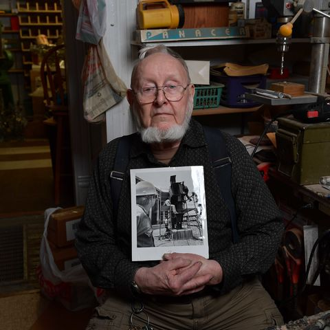 Artist Don Drumm poses with a photo of his sculpture that was shot on May 4, 1970, at Kent State University.
