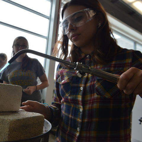 Students at work in the Center for the Visual Arts's Someroski Jewelry/Metals/Enameling Studios