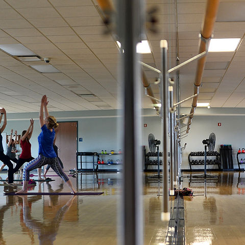 Kent State University employees participate in lunchtime yoga at the Student Recreation and Wellness Center.
