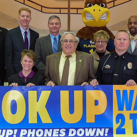 Representatives from Kent State University, the city of Kent, AAA and Portage County Safe Communities are collaborating on a campaign to promote safe driving practices. The campaign Wait2TXT targets both distracted driving and walking.