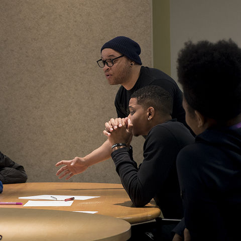 Jamil Wright, a rising 10th grader at Akron's STEM High School, works with other I PROMISE students on their team brand identity during the Flash P'ACT summer program at Kent State.