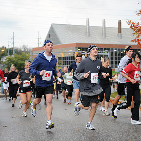 Runners in front of the Kent State Power Plant during the Bowman Cup 5K
