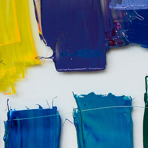 Multicolor paint strokes on white background
