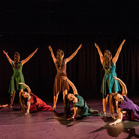 Dance students performing on stage.