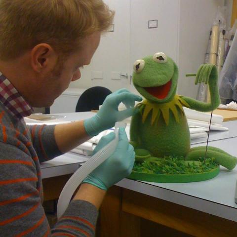 Conservator Howard Sutcliffe with Kermit