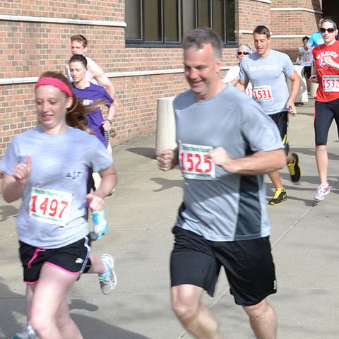 Runners race toward the finish line at Race into Finals