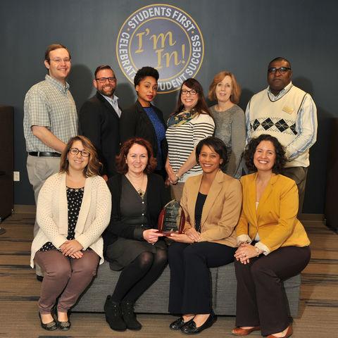 Photo of Eboni Pringle and Exploratory Advising Center staff with award